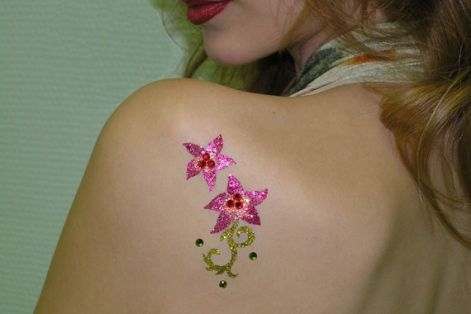 2_pink_flowers_and_1_gold_stalk_...glitter_tattoo_on_back.jpg