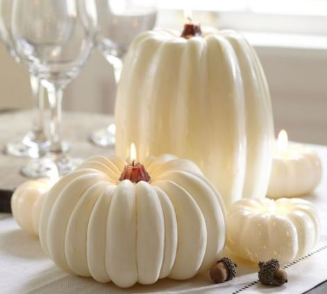 interior-decoration-with-white-candles-pumpkins.jpg